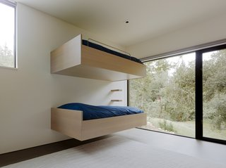 The minimalist, cantilevered bunk beds are a modern interpretation of a traditional bunk room.