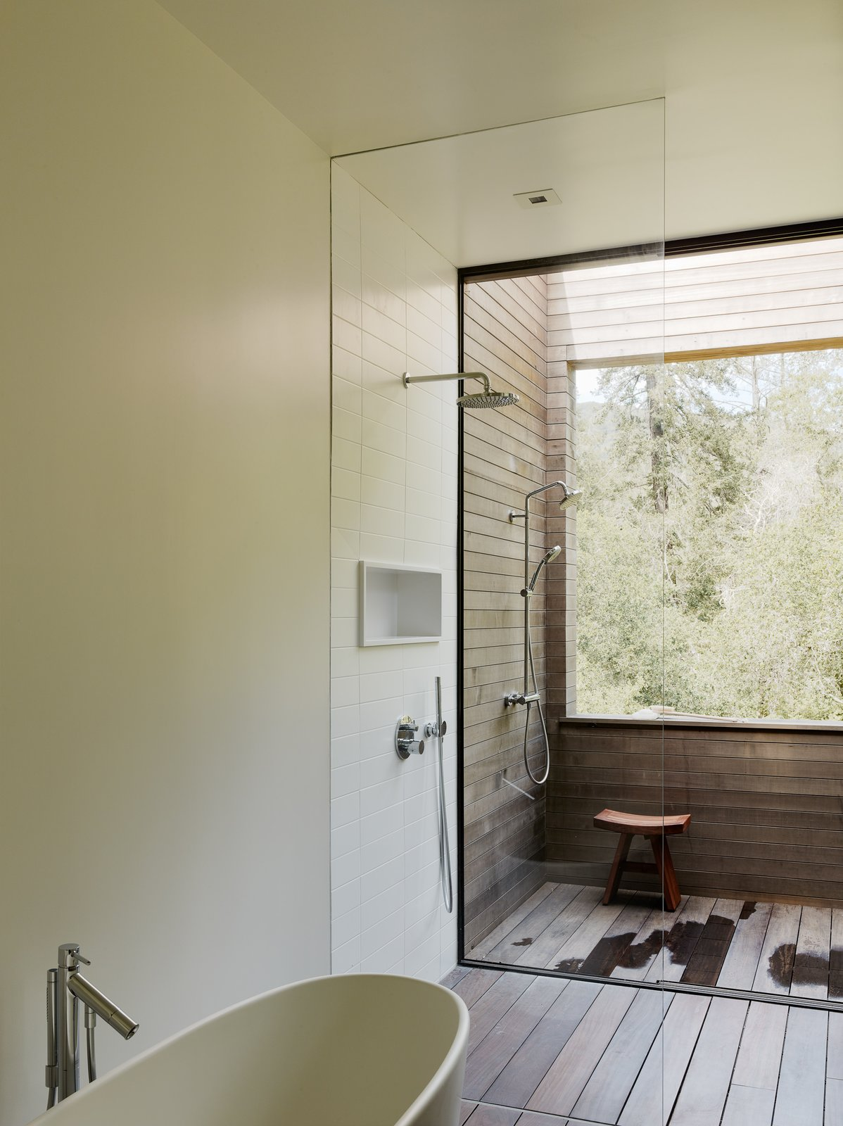 Bath, Freestanding, Open, Recessed, and Dark Hardwood The master suite bathroom features an outdoor shower.   Best Bath Dark Hardwood Recessed Photos from Fall Under the Spell of This Northern California Wine Country Retreat