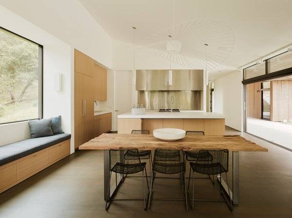 A restrained material palette creates a tranquil atmosphere in the elegantly appointed, open kitchen.