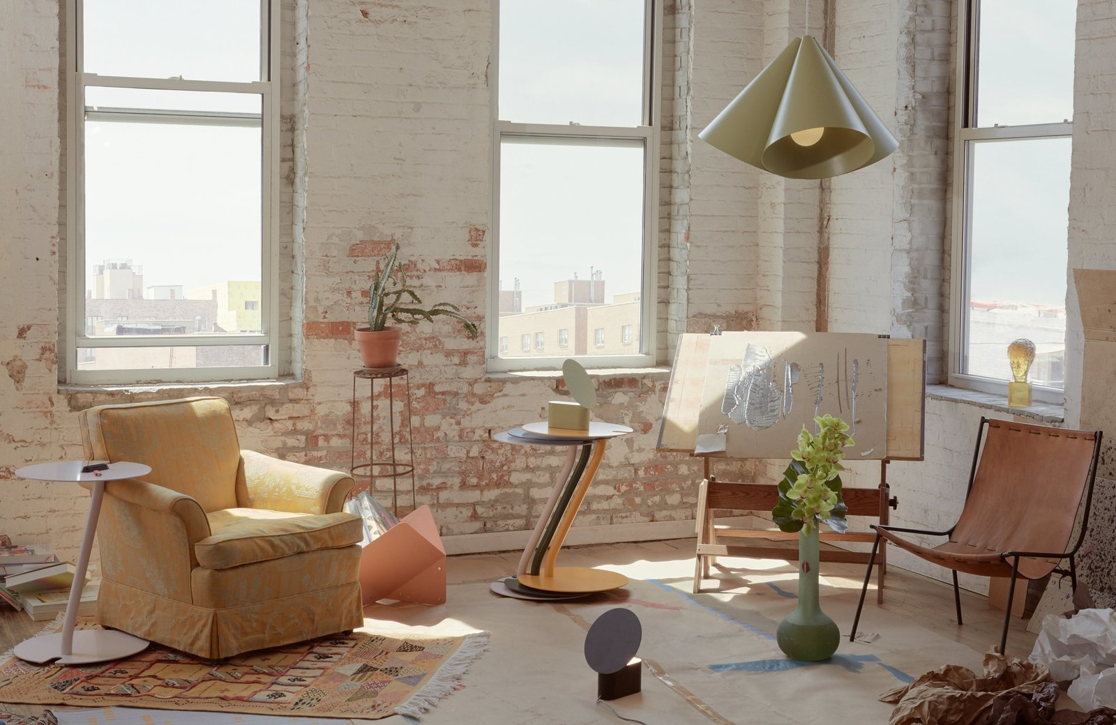 Office, Rug Floor, Craft Room Room Type, and Chair Stylish and functional pieces which help seamlessly integrate your office into your home.  Photo 2 of 6 in Design Digest: Remembering Will Alsop, Elon Musk Makes Bricks, and More