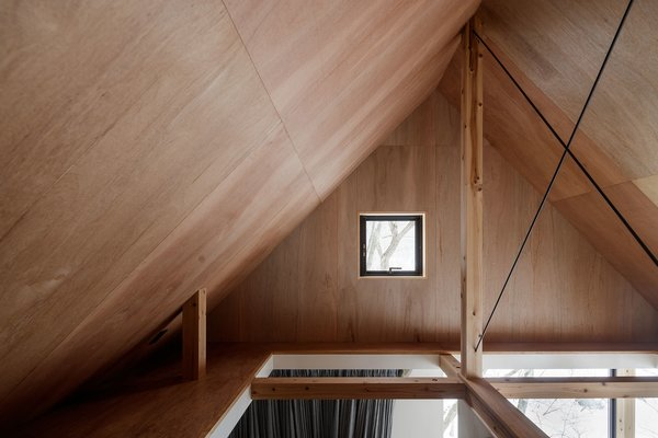 The open attic creates an airy sense of space for the lower levels, and offers more room for storage.