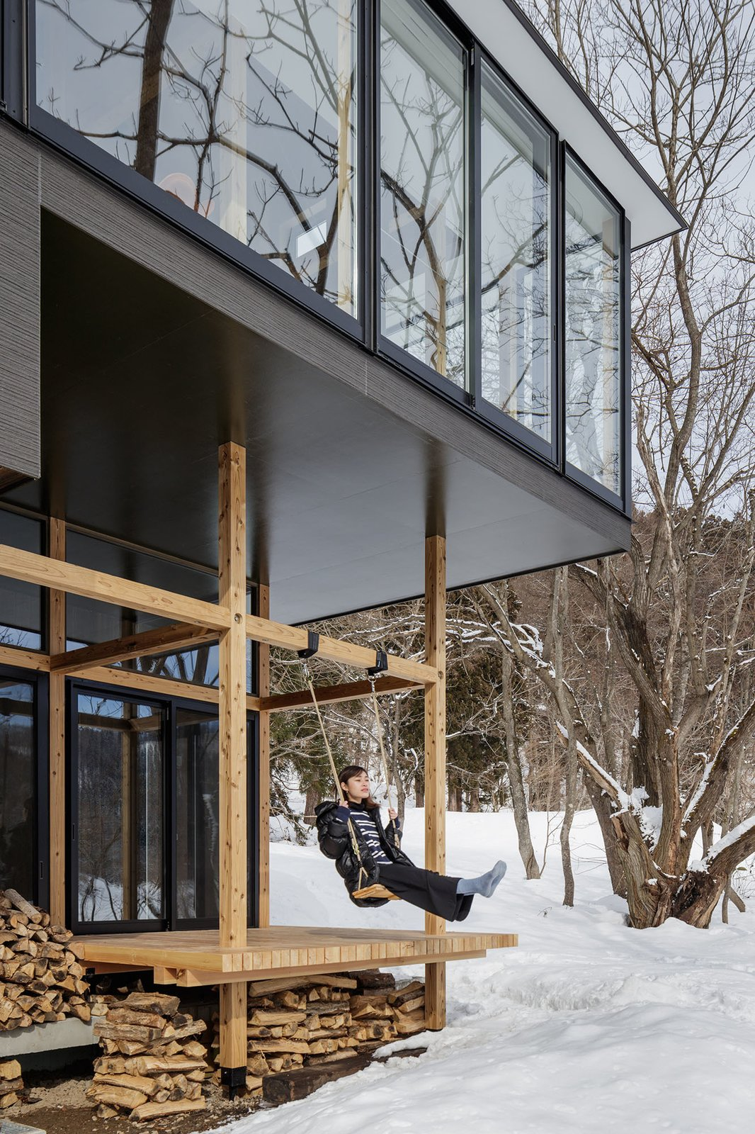 Outdoor, Trees, Back Yard, Small Patio, Porch, Deck, and Wood Patio, Porch, Deck Partially enclosed, the exterior platform features an outdoor swing that is suspended from the timber-framed porch.    Photo 3 of 13 in Playful Platforms Revamp This Japanese Lake House Into a Fun, Five-Story Retreat