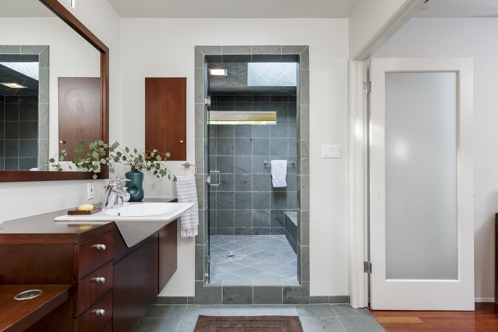 Bath Room, Slate Floor, Wood Counter, Drop In Sink, Ceiling Lighting, and Full Shower A spa-like master bath even has a relaxing wet room.  Photo 14 of 17 in A Southern Californian Midcentury With Japanese Influences Asks $3.13M
