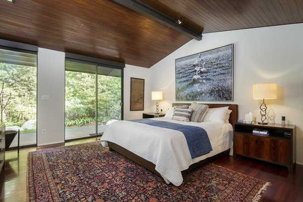 The bedrooms are contained in a private wing with three bedrooms, including the master suite. A fourth bedroom is located downstairs.