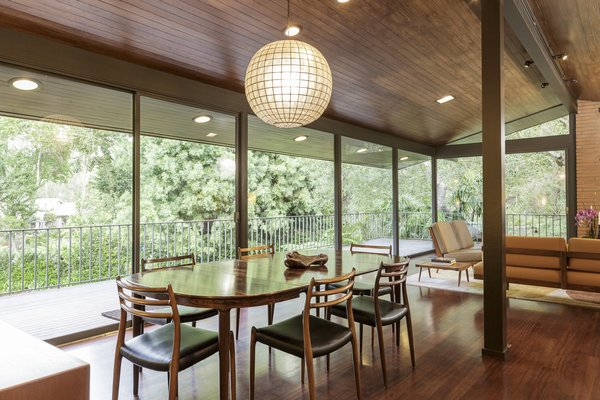 The great room offers direct access to the wide veranda and extensive use of wood combined with the ample glazing brings the outdoors in.