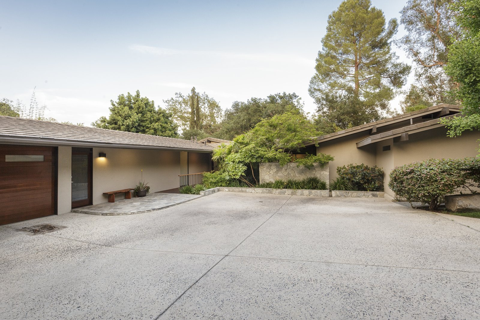 Exterior, Mid-Century Building Type, Wood Siding Material, Gable RoofLine, Shingles Roof Material, and House Building Type The discrete private entrance to the residence has a Japanese country home meets midcentury modern vibe.  Photo 1 of 17 in A Southern Californian Midcentury With Japanese Influences Asks $3.13M