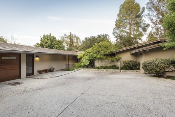 The discrete private entrance to the residence has a Japanese country home meets midcentury modern vibe.