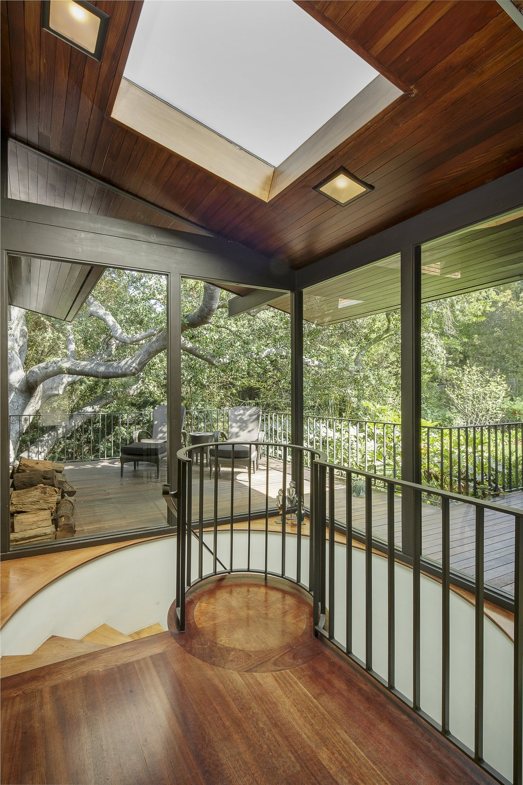 Staircase, Wood Tread, and Metal Railing A spiral staircase leads to the lower level.  Photo 11 of 17 in A Southern Californian Midcentury With Japanese Influences Asks $3.13M