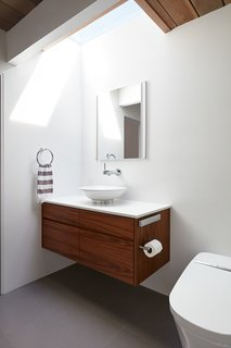 A bathroom skylight increases the sense of space.