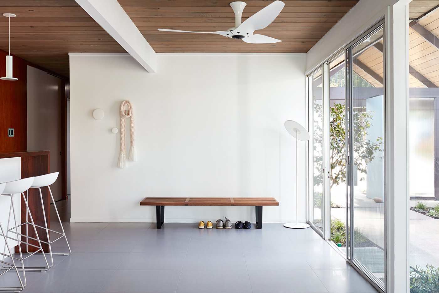 Kitchen The space between the kitchen and atrium is also flooded with natural light.    Photo 8 of 14 in This Eichler Home in California Mixes Scandinavian Vibes With Midcentury Charm