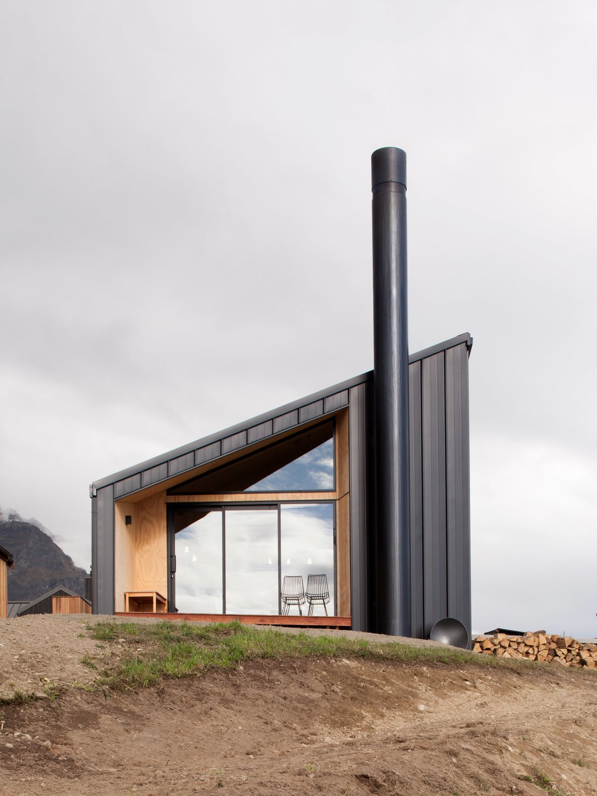 Exterior, Metal, Metal, Cabin, Shed, and Small Home Chin abstracted a simple gable form—a profile which is more common in the area—to create a more contemporary asymmetrical profile.  Best Exterior Shed Metal Metal Photos from A Tiny Cabin Boasts Big Views of the New Zealand Countryside