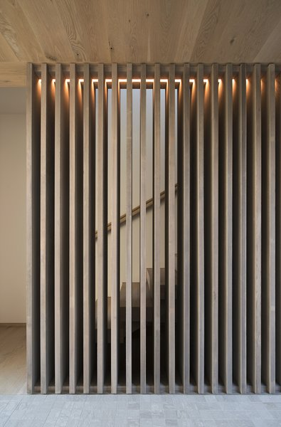A cedar screen adds an openness to the staircase.