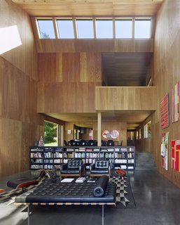 Thirty-foot ceilings feature skylights for increased natural lighting. The walls are paneled in larch and provide concert-hall quality acoustics, and the floors are a polished black concrete.