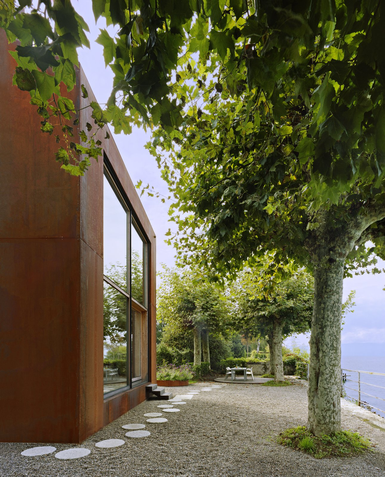 Exterior, Metal Roof Material, Metal Siding Material, and House Building Type Sitting less than 20 feet from the water's edge, the home enjoys a spectacular lakeside view.  Photo 2 of 13 in A Sculptural Steel Abode on Lake Geneva Is Up For Auction