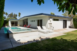 The private backyard has ample space for poolside entertaining.