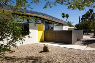 The home has a sunny yellow door that is picked up as a bright and fun accent color throughout.