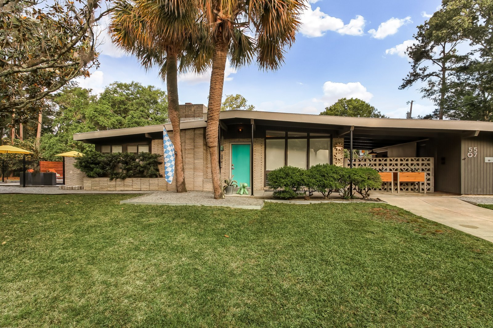 Exterior, Mid-Century, Brick, Glass, House, and Wood The stylish midcentury has an elegant profile.     Best Exterior Glass Brick Wood Photos from A Carefully Restored Midcentury Hits the Market at $415K in Savannah, Georgia