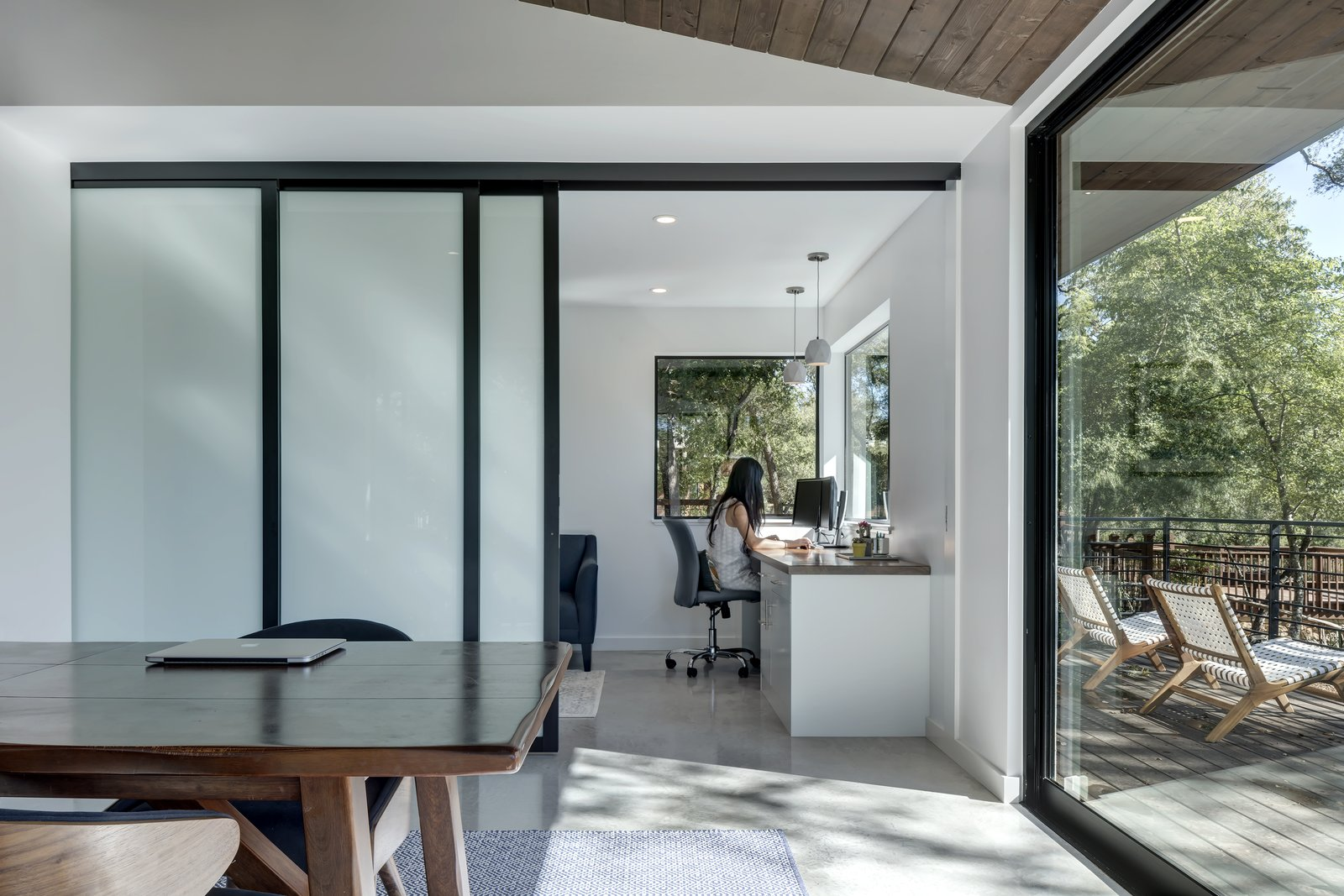 Office, Chair, Concrete, Desk, and Rug Wood ceilings extend out, further strengthening the indoor/outdoor connection.     Best Office Desk Concrete Photos from An Austin Midcentury Welcomes a Discreet Home Office Addition