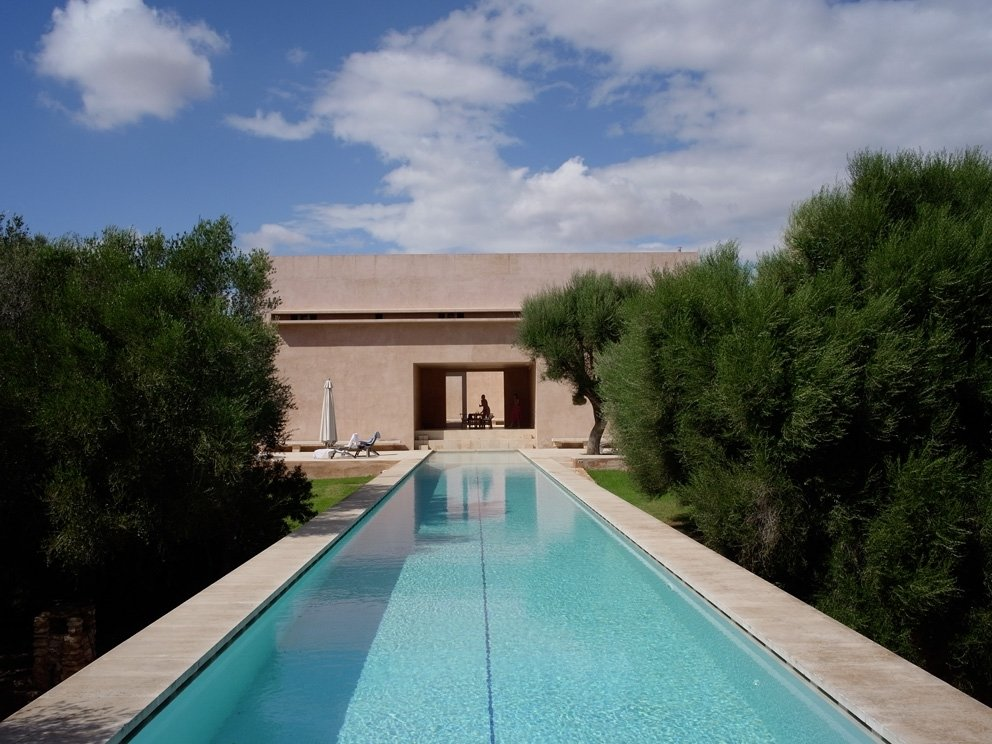 Outdoor, Large Pools, Tubs, Shower, Large Patio, Porch, Deck, and Side Yard There is also a luxurious 98-foot-long infinity pool set into the landscaping.    Photo 11 of 11 in This John Pawson-Designed Retreat in Mallorca Is a Minimalist's Dream