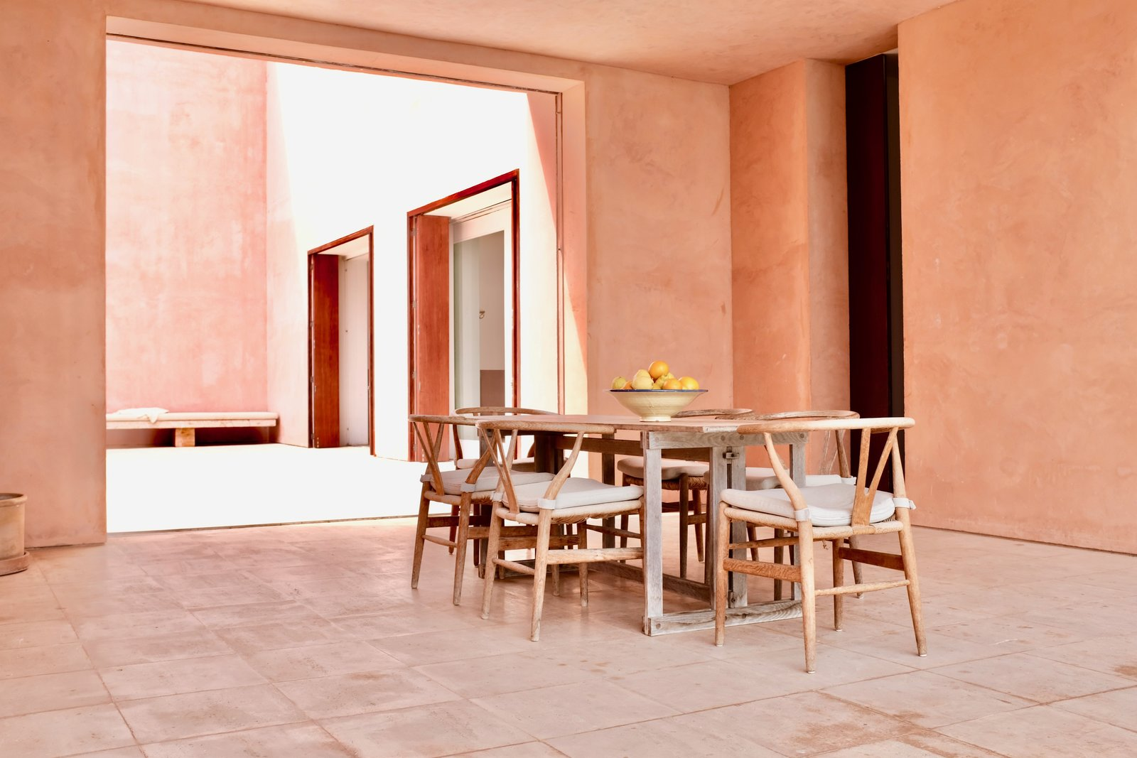 Dining Room, Chair, and Table This Mallorcan villa was Pawson's firm's first full architectural project. It was originally built for German art dealers, who Pawson had met by chance on an Italian beach. Acclaimed for his minimalism, this beautiful abode is no different.     Photo 1 of 11 in This John Pawson-Designed Retreat in Mallorca Is a Minimalist's Dream