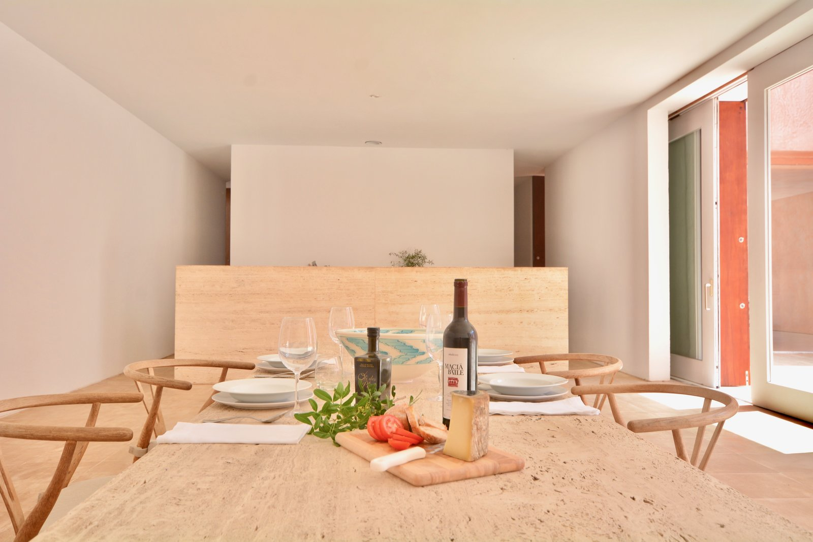 Dining Room, Chair, and Table The kitchen and the adjoining dining area sit nearby the poolside terrace.     Photo 7 of 11 in This John Pawson-Designed Retreat in Mallorca Is a Minimalist's Dream