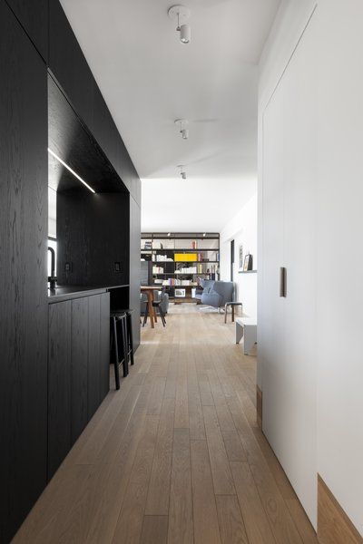 """A glance down the hallway from the junction of the two prefab """"boxes."""""""