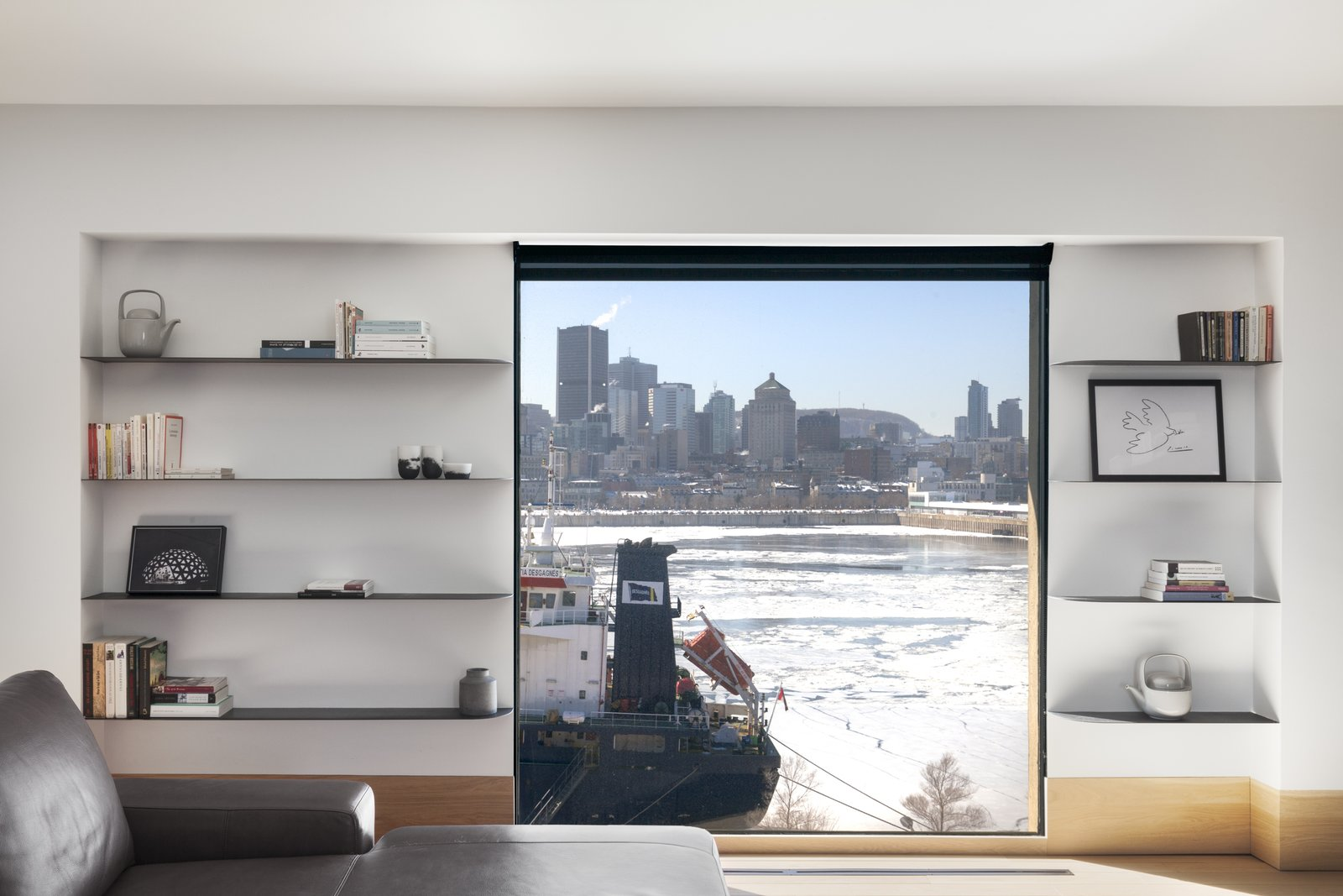 Storage and Shelves The minimalist design of the space was also informed by the location of Habitat 67 on the Saint-Laurence River—a windy and isolated spot during the long cold winter months.     Best Storage Shelves Photos from An Iconic T-Shaped Apartment Receives a Modern Makeover