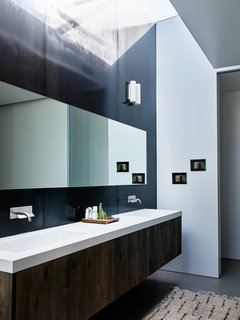 A bathroom skylight brings in additional natural light.