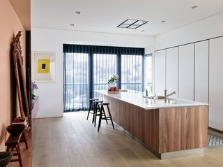 The streamline design of the kitchen is practically camouflaged into the design of the home.