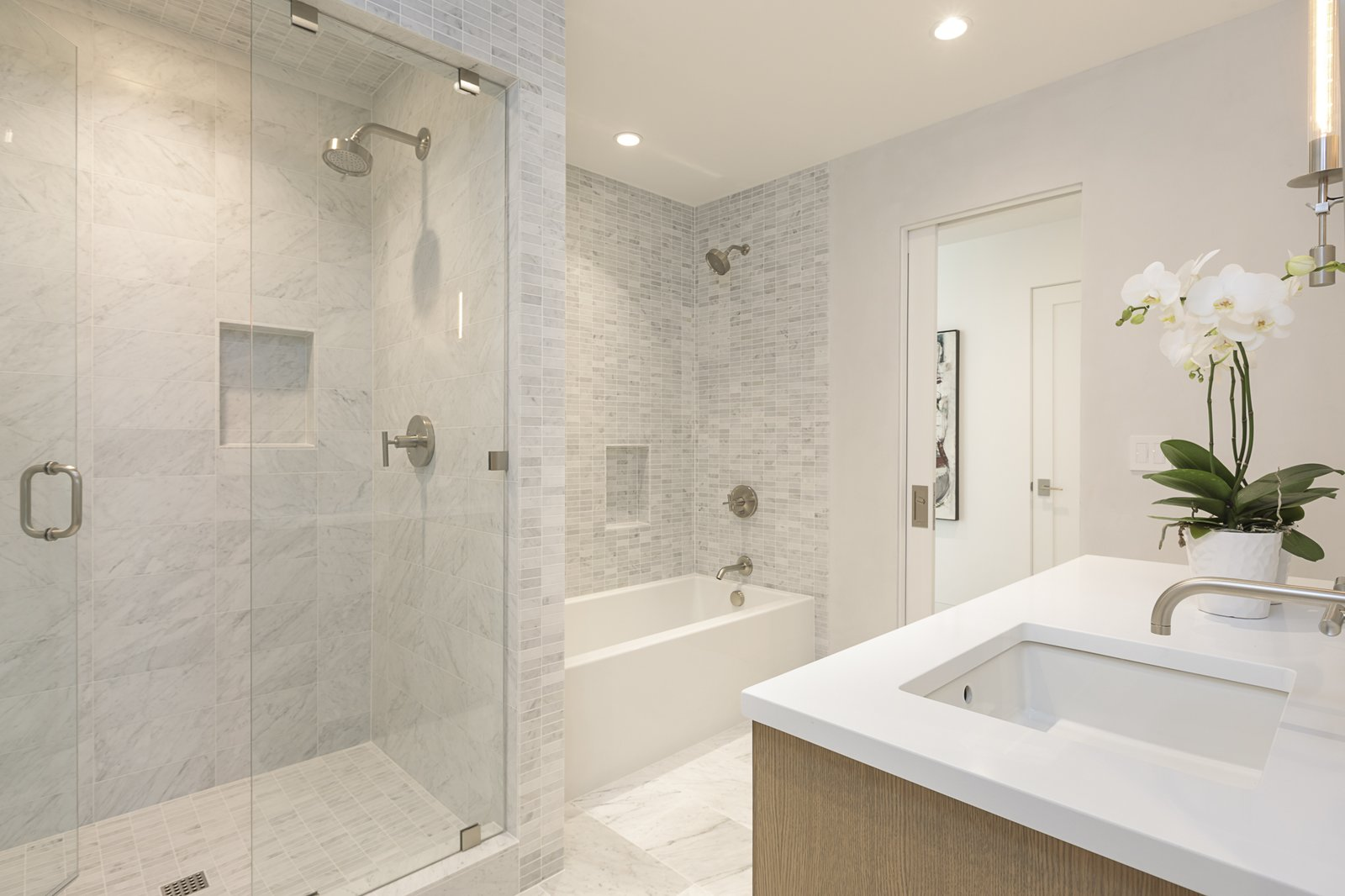 Bath Room, Recessed Lighting, Alcove Tub, Quartzite Counter, Mosaic Tile Wall, Enclosed Shower, Full Shower, and Undermount Sink More so, a bathroom was added to the suite.   Photo 19 of 24 in An Iconic Portland Midcentury Is Seeking a New Owner For $1.6M