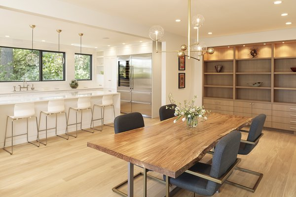 At the other end, he added floor-to-ceiling, built-in shelving, which has created a more streamlined look and eliminated the need for additional furniture.