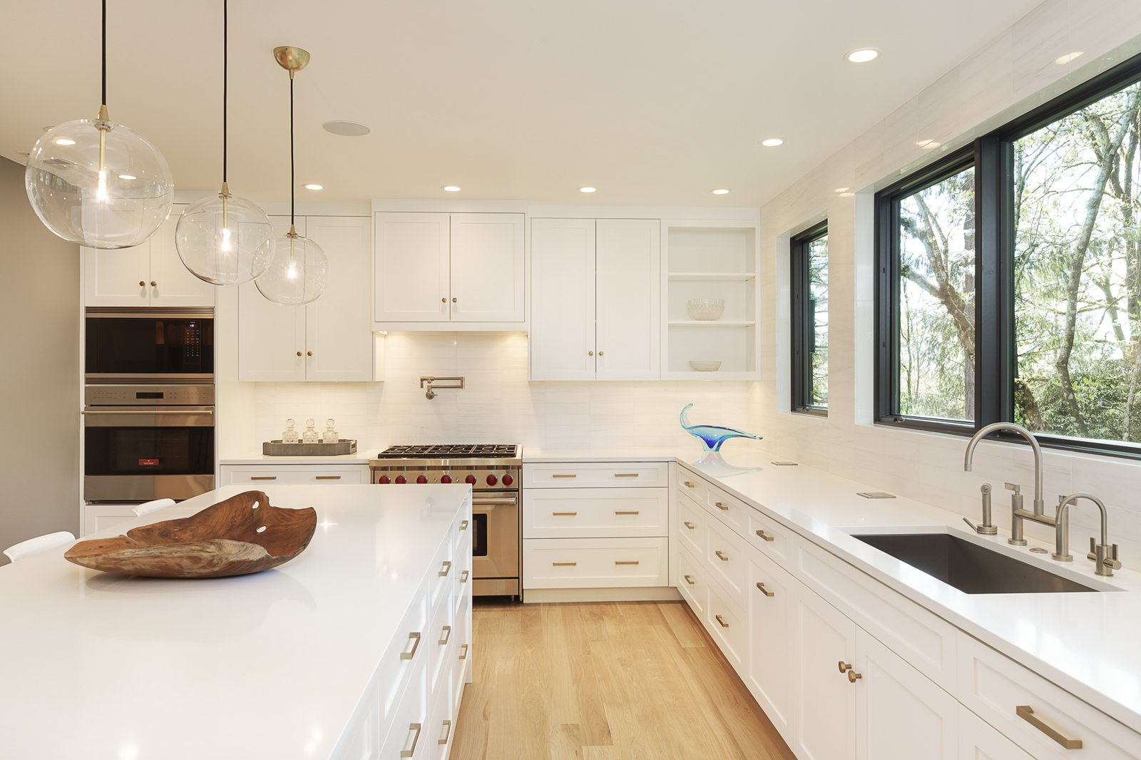 Kitchen, Quartzite, Recessed, Range, Light Hardwood, White, Marble, Pendant, Undermount, and Wall Oven The transformed kitchen shows off how bright the home is now.   Best Kitchen Wall Oven White Marble Photos from An Iconic Portland Midcentury Is Seeking a New Owner For $1.6M
