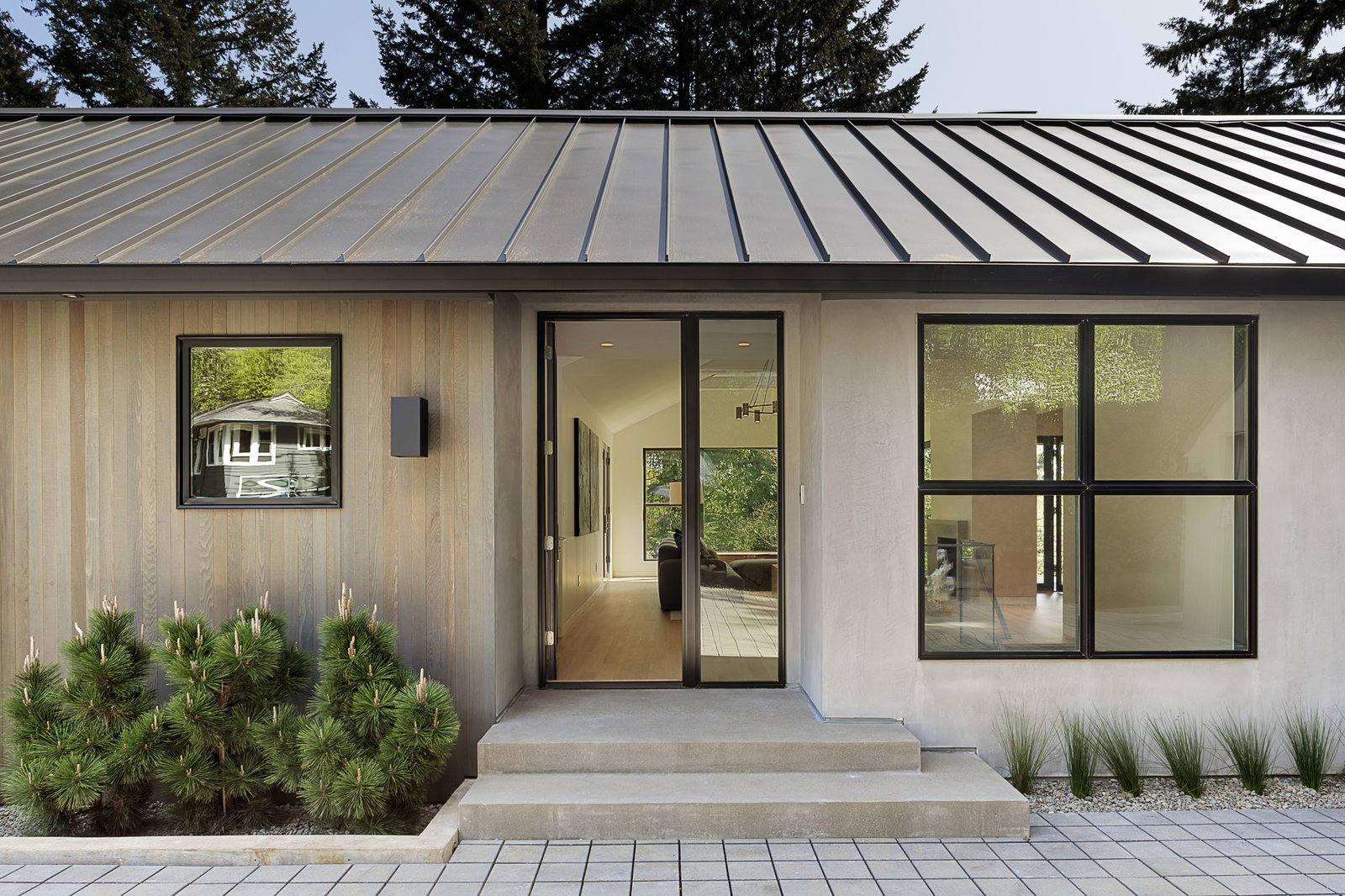 Exterior, House Building Type, Metal Roof Material, Wood Siding Material, Mid-Century Building Type, Concrete Siding Material, and Gable RoofLine Thanks to a complete revamp, this midcentury gem now has a fresh new look.     Photo 4 of 24 in An Iconic Portland Midcentury Is Seeking a New Owner For $1.6M