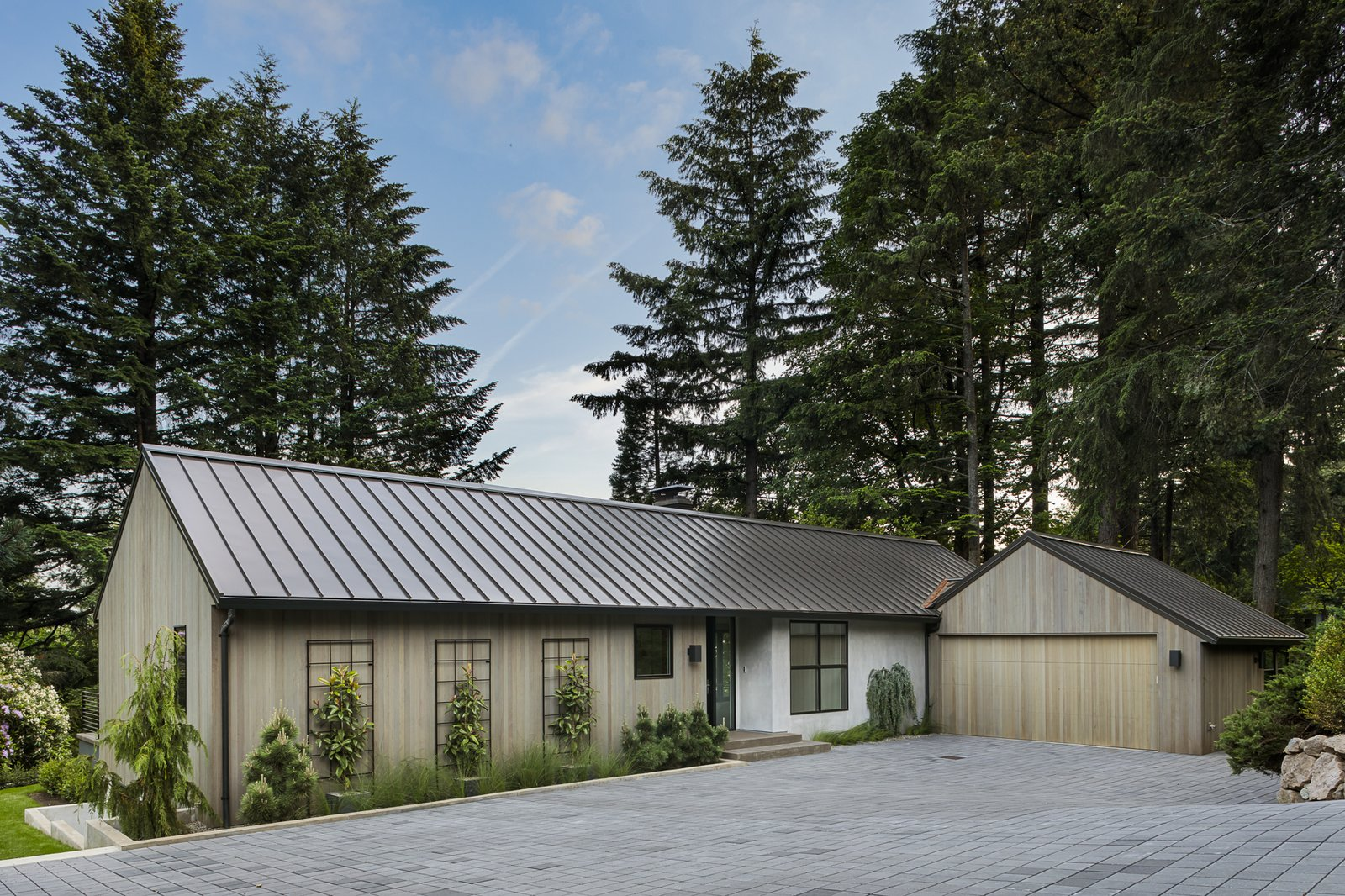 Exterior, Mid-Century, Wood, Gable, Metal, House, and Concrete Although Silver did not follow the original footprint exactly, the new layout was clearly inspired by Hemenway's design.     Best Exterior Metal Wood Gable Concrete Photos from An Iconic Portland Midcentury Is Seeking a New Owner For $1.6M