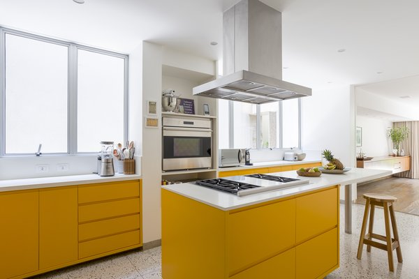Bright yellow cabinets in the kitchen add a playful, fun touch, while also maintaining to same sleek, contemporary look.