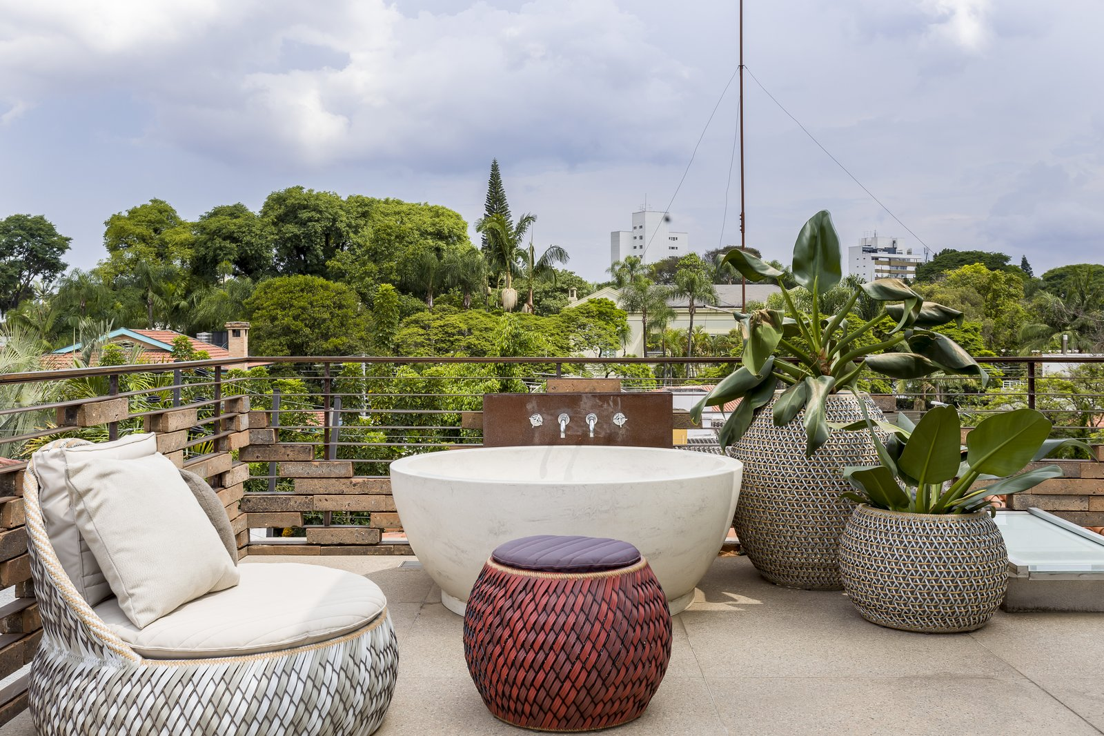 Outdoor, Large Patio, Porch, Deck, Rooftop, Horizontal Fences, Wall, Trees, and Hot Tub Pools, Tubs, Shower An upper-level media room.     Photo 12 of 13 in Lush Gardens Infuse Tropical Vibes in This Chic Brazilian Home