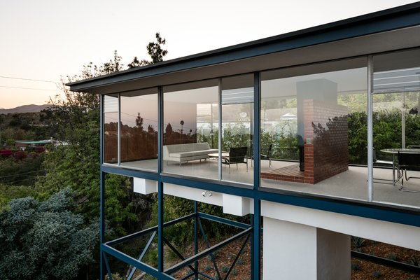 """At night, the Smith House appears to float like a glass box in space."