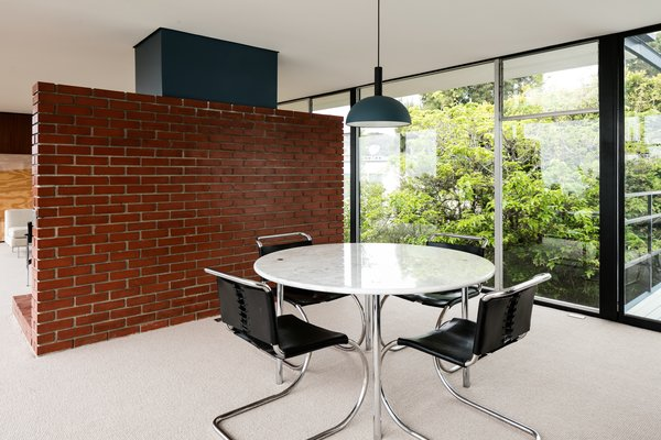 Here, you can see how the dining area and kitchen are behind the dividing wall.