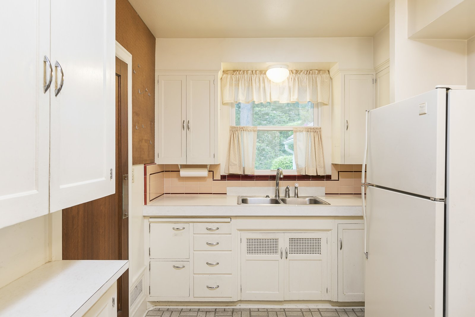Before the revamp, the kitchen was tiny and cramped.   Photo 11 of 24 in An Iconic Portland Midcentury Is Seeking a New Owner For $1.6M