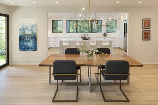 Silver opened the kitchen to the dining room, creating the sense of one big space with a seamless flow. He also inserted sliding doors to an exterior patio.