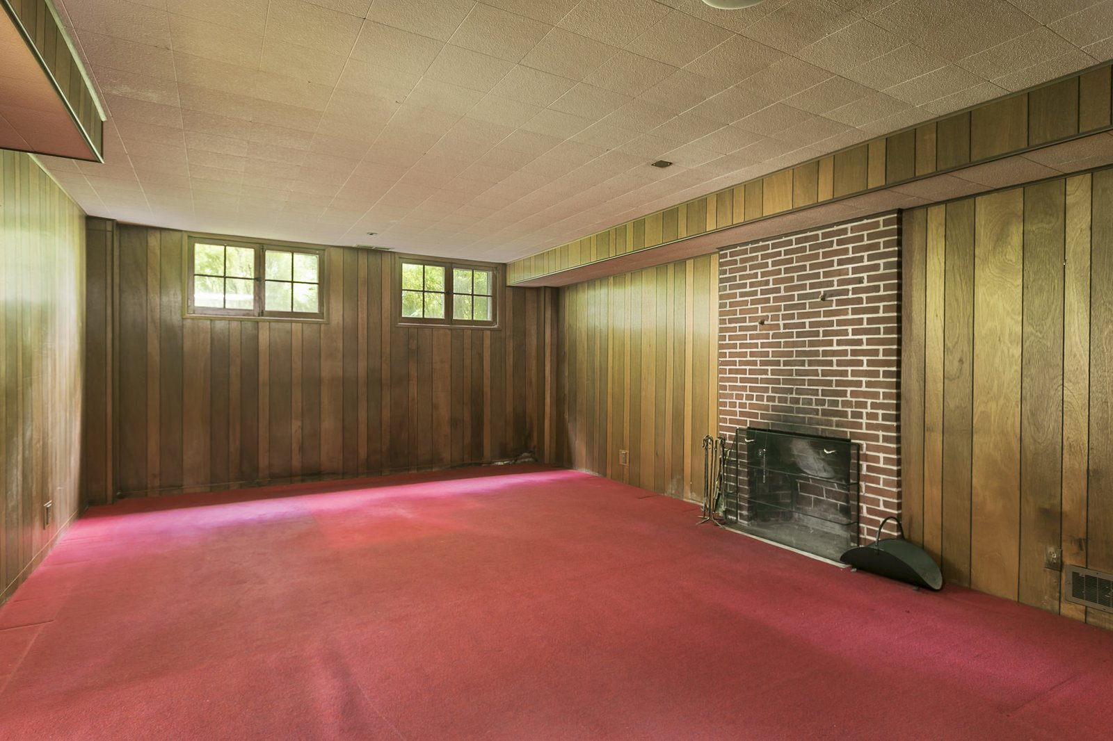 Before, this space was dark and featured wood paneled walls.   Photo 20 of 24 in An Iconic Portland Midcentury Is Seeking a New Owner For $1.6M