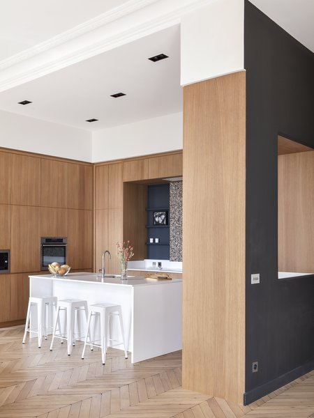 Designed by Hermand, the made-to-measure kitchen anchors the semi-open plan layout.