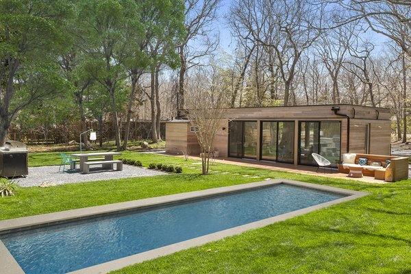 A Revamped Midcentury Wrapped in Glass and Timber Is Listed For $1.25M