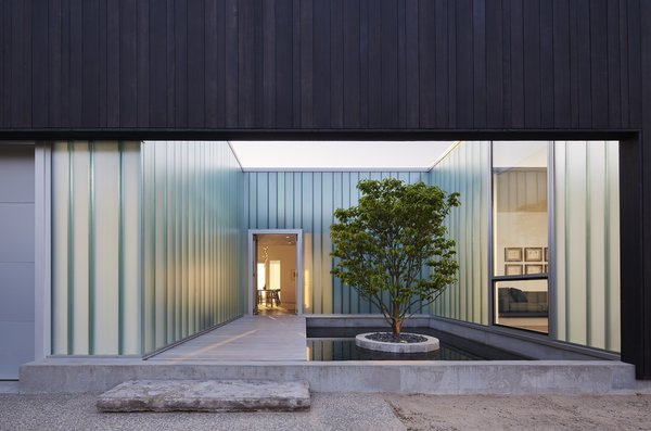 The home is organized around a series of four outdoor courtyards.