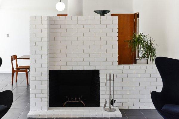 A detail of the original brick wood-burning fireplace.