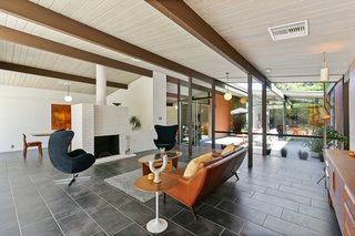 The expansive open-plan living area is also bright and airy.