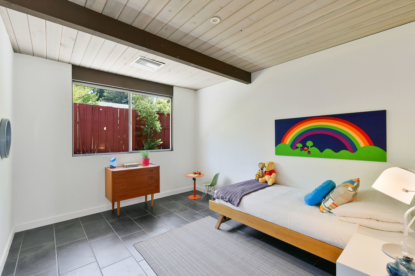 Kids, Bedroom, Bed, Lamps, Dresser, and Porcelain Tile In total, there are four bedrooms in the home.     Best Bedroom Dresser Night Stands Photos from A Bright and Breezy Eichler Hits the Market at $1.45M in California
