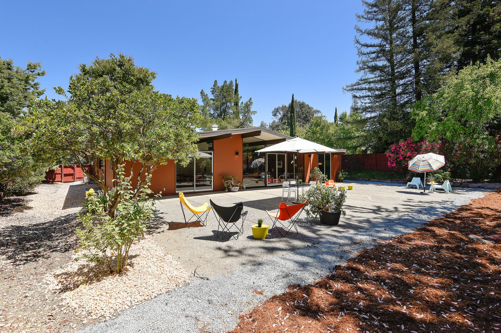 Outdoor, Shrubs, Large Patio, Porch, Deck, Concrete Patio, Porch, Deck, Stone Patio, Porch, Deck, Back Yard, Trees, and Hardscapes The property is located on a large corner and close to numerous outdoor activities.     Photos from A Bright and Breezy Eichler Hits the Market at $1.45M in California