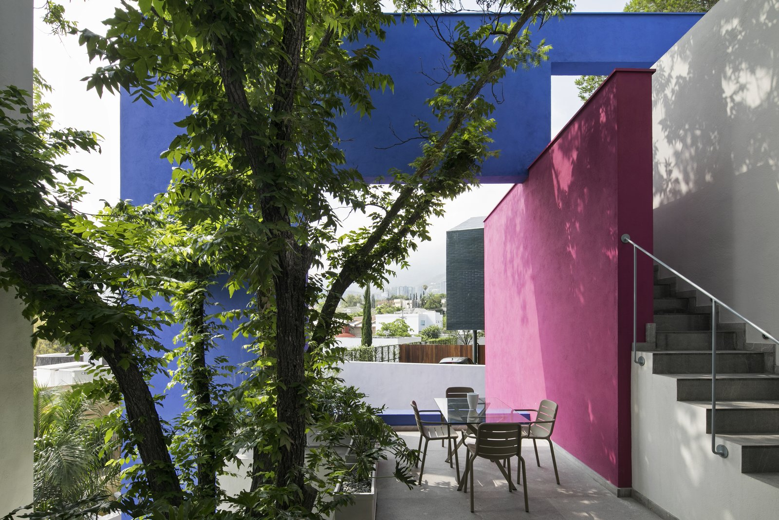 Outdoor, Large Patio, Porch, Deck, Rooftop, Trees, and Side Yard The roof terrace is conceived as a large exterior room, delimited by walls and windows that frame the fantastic views of the Monterrey mountains.  Photos from A Bright Mexican Home Brilliantly Weaves Nature Into its Design