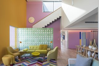 The interiors are a mix of vibrant wallpapers that create murals to provide color and design, geometrically patterned Mexican tiles and designer furniture.